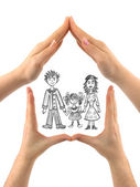 Family in house made of hands — Foto Stock