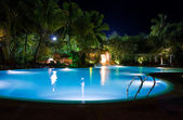 Pool and waterfall at night — Stockfoto