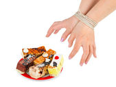 Cakes and bound hands — Stock Photo