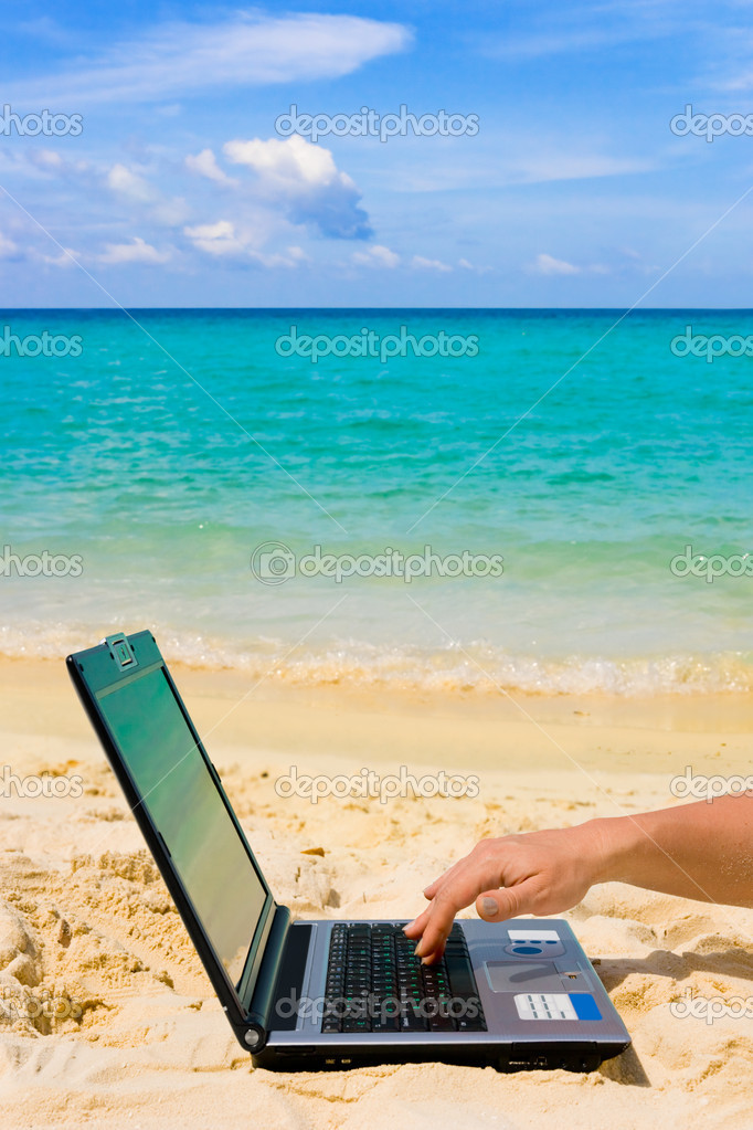 Computer and hand on beach, business travel background  — Stock Photo #1180388