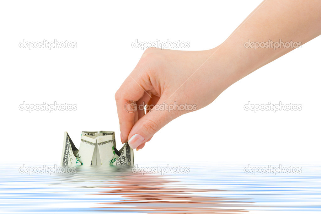 Hand launching money ship isolated on white background — Stock Photo #1181066