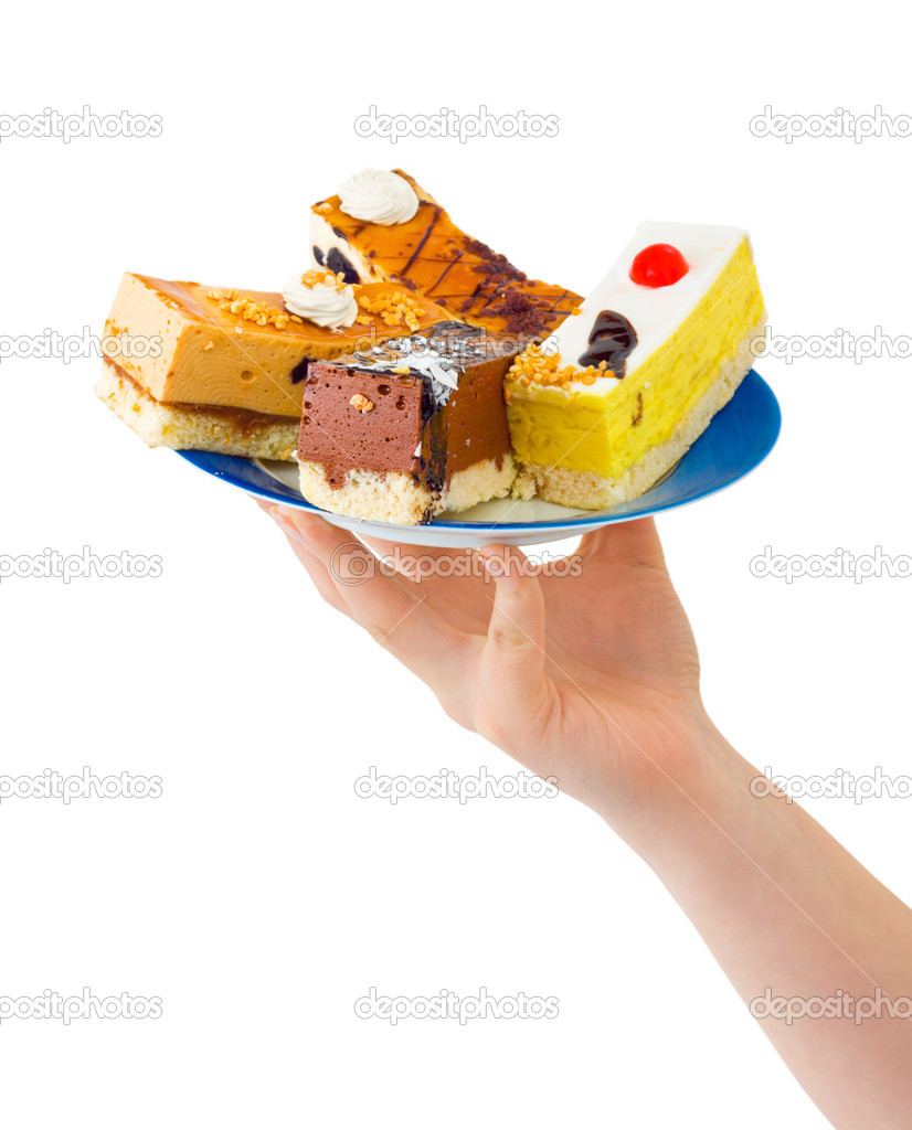 Hand giving plate with cakes isolated on white background — Stock Photo #1183994
