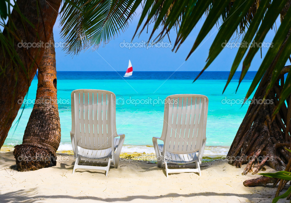 Tropical Beach Chairs Chairs on tropical bea...