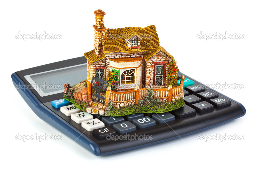 Calculator and house isolated on white background  Stock Photo #1184914