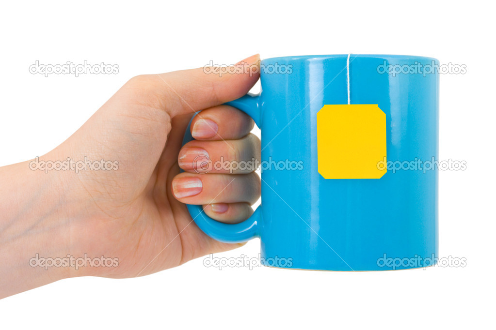 Hand and cup of tea isolated on white background  Stock Photo #1185464
