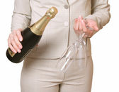 Bottle of a champagne and two glasses — Stock Photo