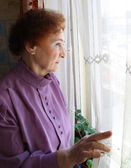 Woman looking outside — Stock Photo