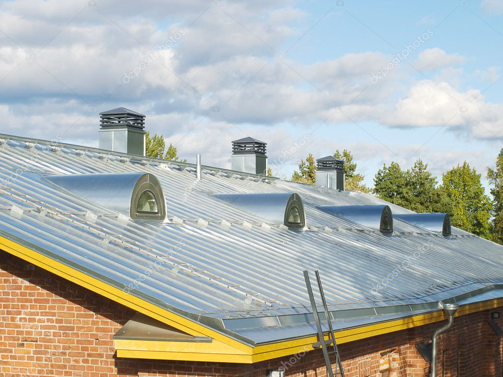 New steel pitched roof with water drain system and air ducts. — Stock Photo #1173367