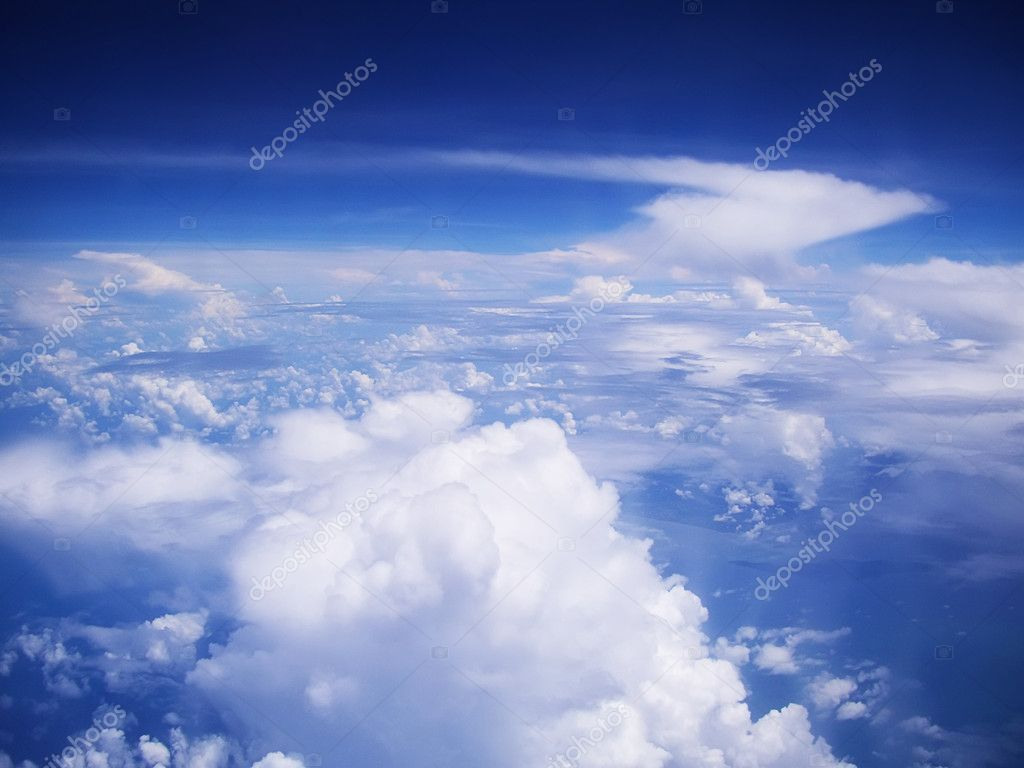 View on cloudscape and blue sky from above — Stock Photo #1173600
