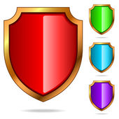 Set of color glossy shields — Stock Vector