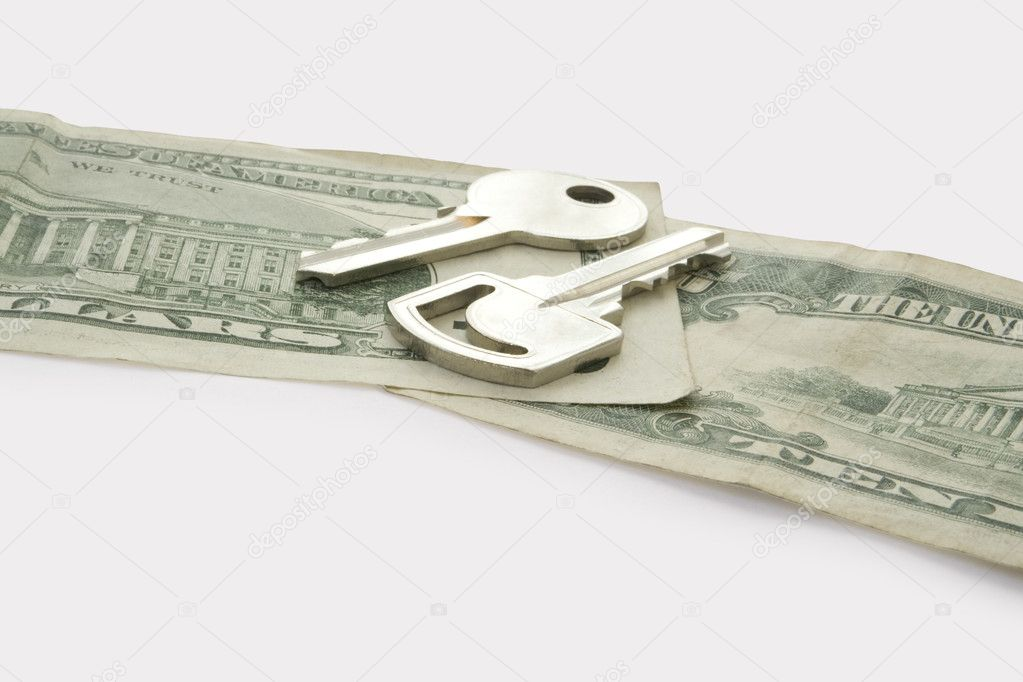 Two keys on dollars isolated on white background — Stock Photo #1170366