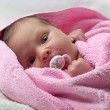 Infant baby in pink towel — Stock Photo #1219413