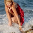 Woman in red dress in sea sparks — Stock Photo #1219494