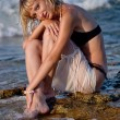 Young woman at beach in water — Stock Photo
