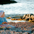 Royalty-Free Stock Photo: A baby sitting near the sea