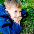Boy in grass — Stock Photo