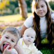 Brother with two sisters — Stock Photo