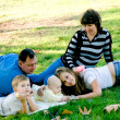 Family relaxing outdoors — Stock Photo