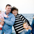 Happy family at the beach - Stock Photo