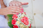 Wedding bouquet, hands and rings — Stock Photo