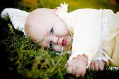 Pretty baby girl on grass — Stock Photo
