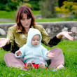 Mother and child on grass — Stock Photo