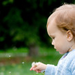 Pretty child and dandelion — Stock Photo