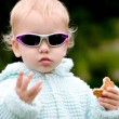 Stock Photo: Funny baby with cookies