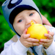 Baby boy eating big apple — Stock Photo