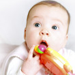 Portret of a baby with a rattle - Stock Photo