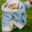 Baby sitting on the grass — Stock Photo #1221136