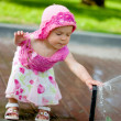 Stock Photo: Child playing with sprinkler