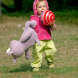Stock Photo: Runnung toddler with a ball and a hippop