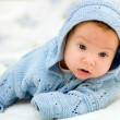 Portret of a baby in blue jacket — Stock Photo