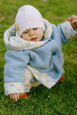 Baby sitting on the grass — Stok fotoğraf