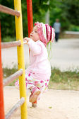 Child climbing on bars — Stock Photo