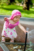 A child playing with sprinkler — Stock Photo