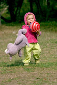 Runnung toddler with a ball and a hippop — Stock Photo