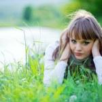 Beautiful woman in grass — Stock Photo