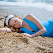Stock Photo: Nice woman relaxing near sea