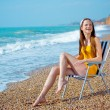 Stock Photo: Smiling woman at beach