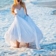 Shouting bride in sea spume - Stock Photo