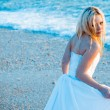 Bride on sea coast — Stock Photo