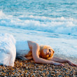 Stock Photo: Trash the wedding dress