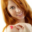 Royalty-Free Stock Photo: Girl with red hair holding a heart