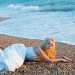 Bride lying at sea coast — Stock Photo