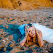 Bride on sand at beach — Stock fotografie