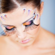 Fashion make-up with face art — Stock Photo