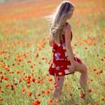Girl in poppy field — Stock Photo #1245706