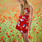 Girl in poppy field — Stock Photo #1245714